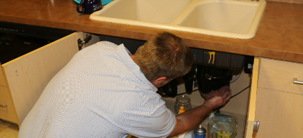 A plumber at work shows expertise.
